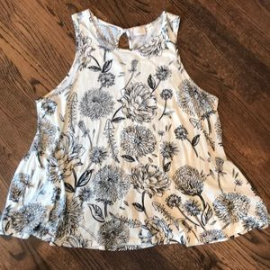 Cream and black floral top with peplum back